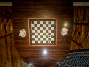 Glimpse into the interior of the Checkmate Room. Wonder what that chess board is for?